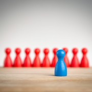 Stand out and be unique - leadership business concept with pawns
